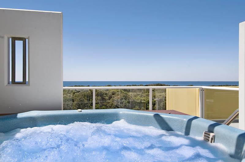 Relax in your private heated plunge pool and spa at Seachange Coolum